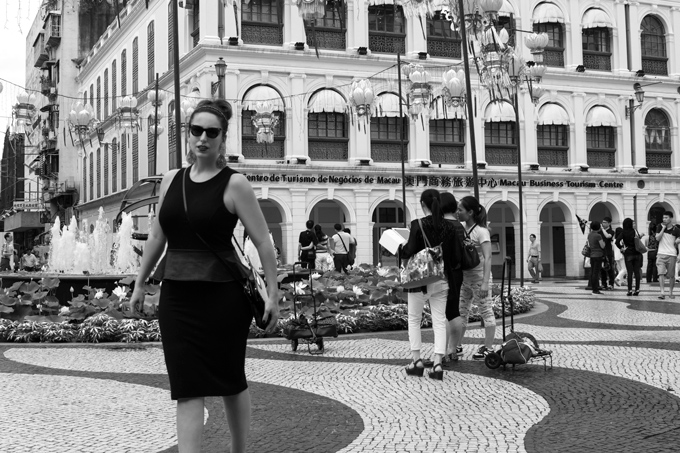 Jessica Peterson in Macao black and white cobblestone streets
