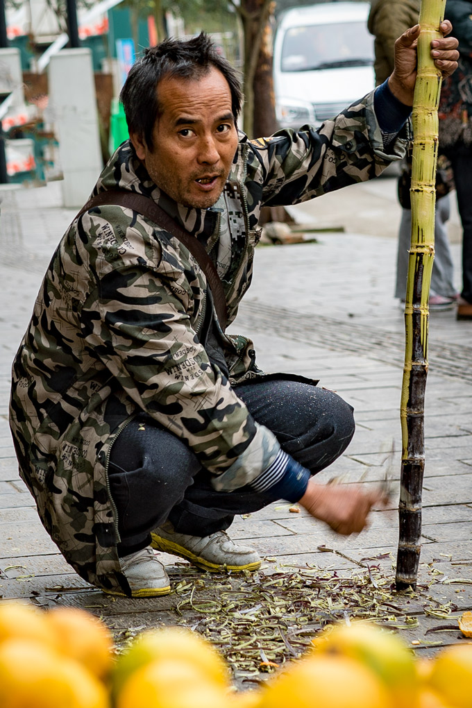 Man carving bamboo in Zhangjiajie, China