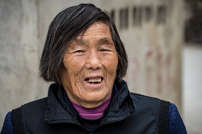 Old woman smiling in Zhangjiajie, China