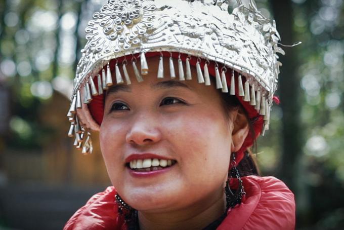 Chinese girl musician at Tianmen National Park, China