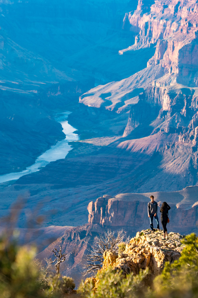 Two hikers pose for a photograph at the Watchtower at Grand Canyon, Arizona