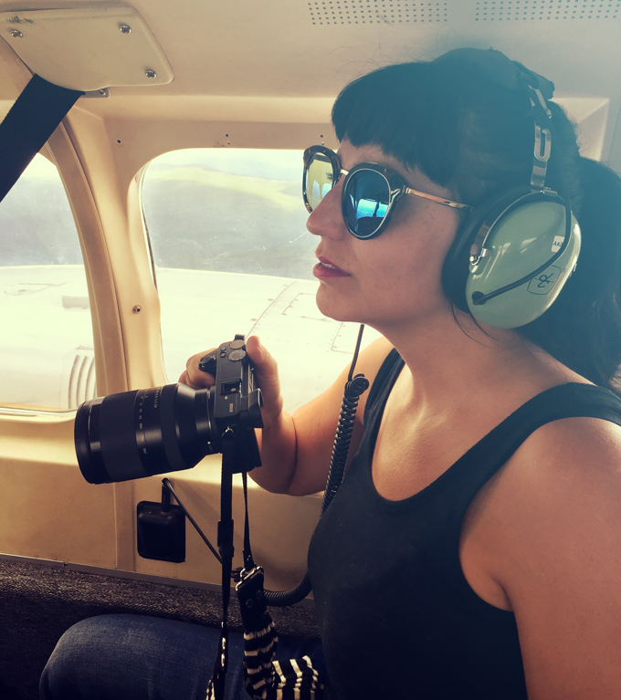 Jessica Peterson of Global Girl Travels on a plane in Alaska with Sony camera