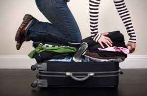 girl overflowing suitcase