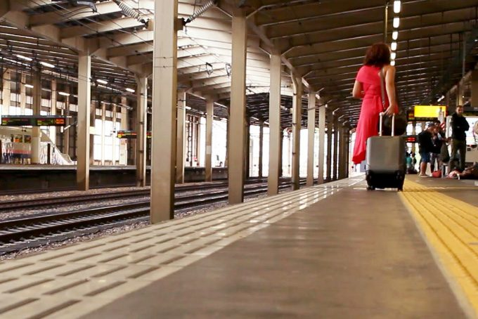 woman with suitcase in japan train station