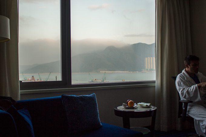 Man in robe in Marriott hong Kong hotel room