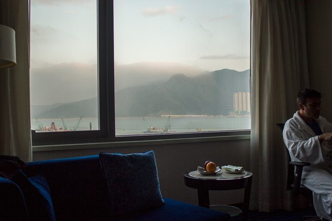 Man in robe in Marriott hong Kong hotel room