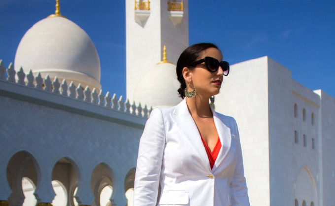 Jessica Peterson, girl in white jacket, standing outside Grand Mosque in Abu Dhabi, United Arab Emirates