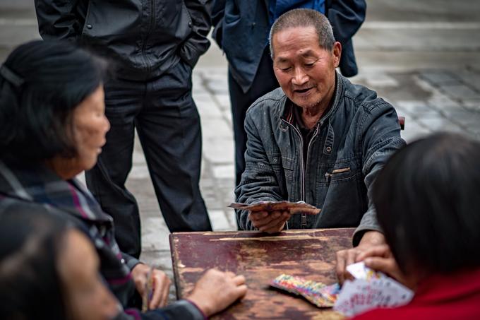 Man playing cards in Zhangjiajie, China