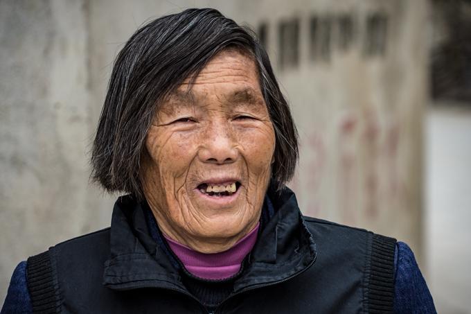 Old woman smiling in Zhangjiajie, China