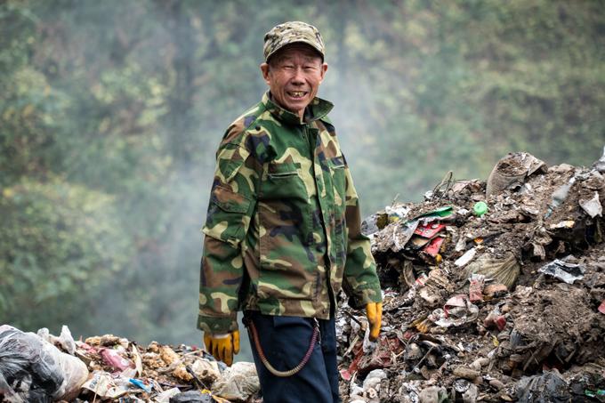 Man sifting trash in Zhangjiajie, China