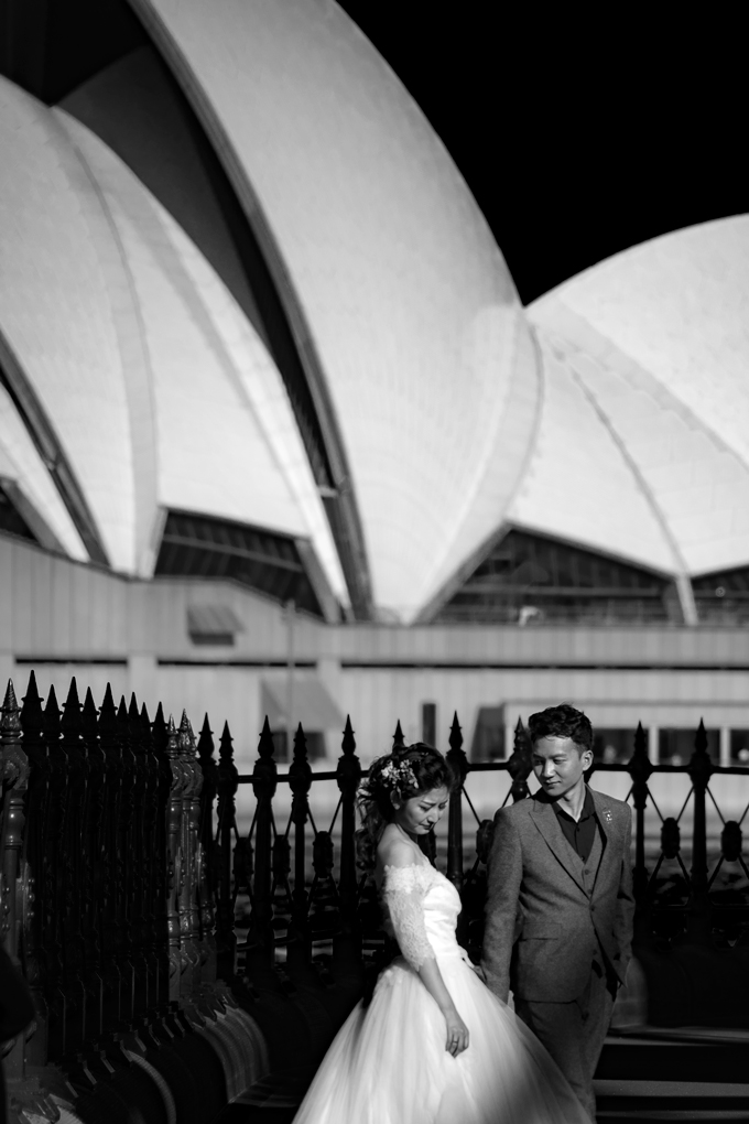 Asian wedding couple taking pictures at Sydney Opera House, Australia