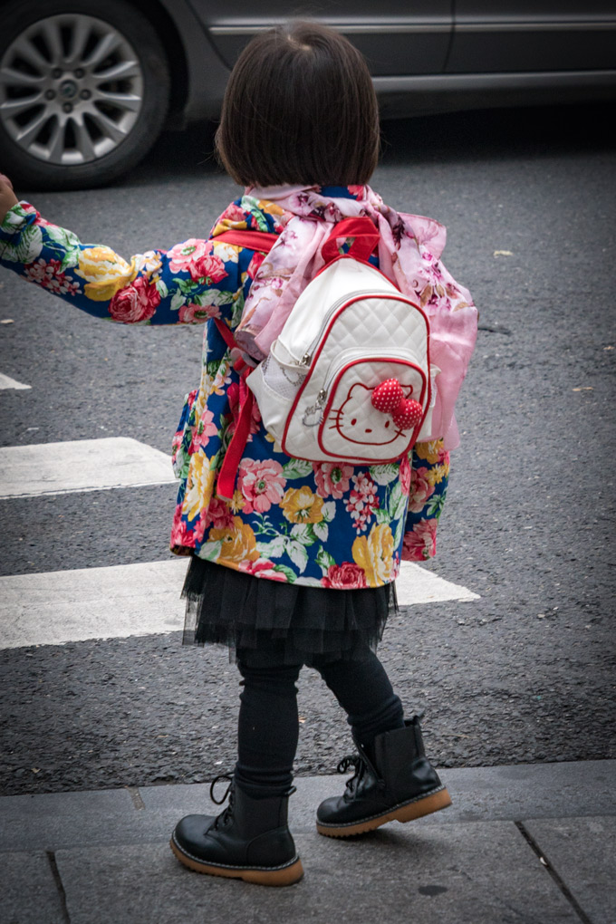 Little girl with Hello Kitty backpack in Shanghai, China