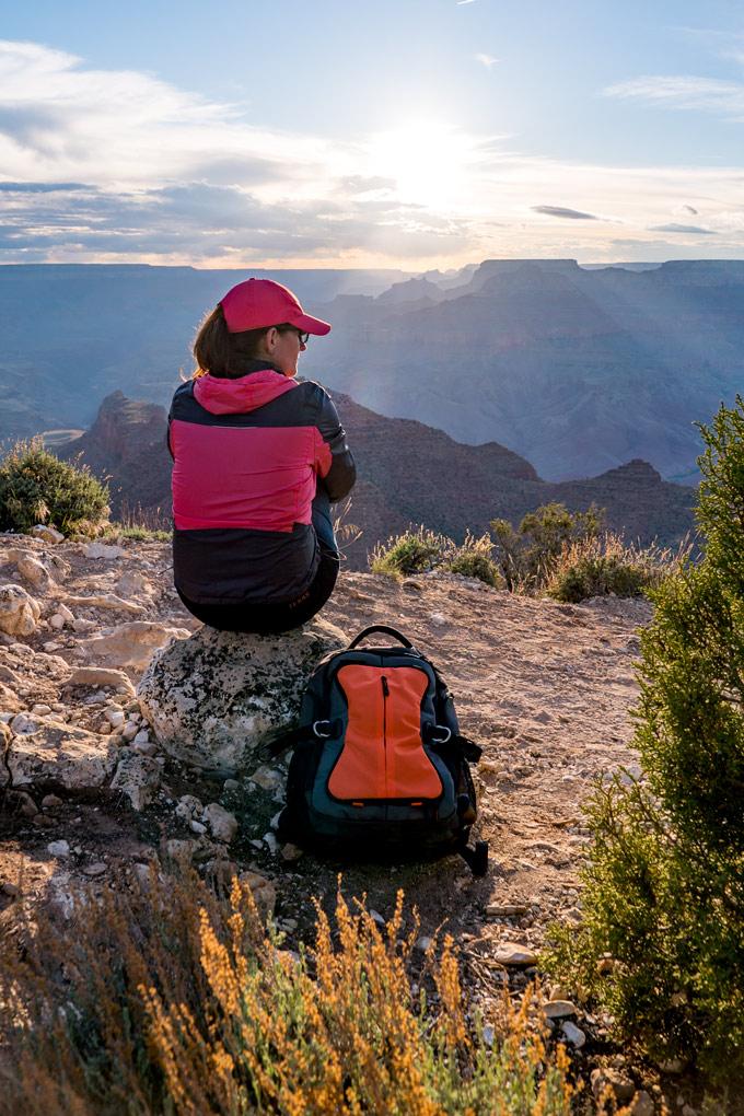 Hiker with backpack at Watchtower at Grand Canyon, Arizona