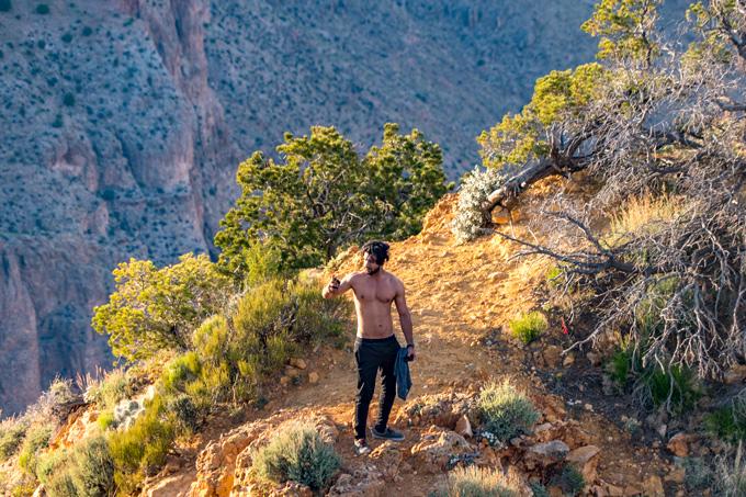 Shirtless man posing at the Watchtower Grand Canyon, Arizona
